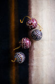 Four Christmas baubles