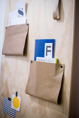 Leather straps used as containers on DIY plywood organiser