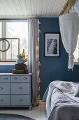 Chest of drawers in bedroom decorated in shades of blue and grey