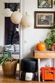 Pleated paper lamps in doorway in vintage-style living room