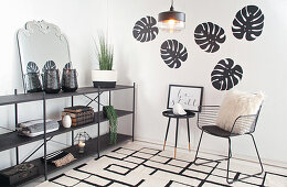 Designer chair and shelving in black-and-white interior