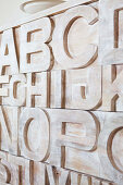Detail of carved letters on wooden cabinet