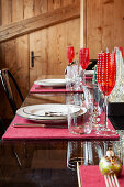Festively set table in dining area of chalet