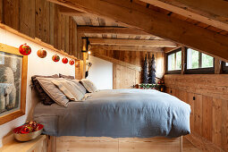 Double bed in festively decorated bedroom in chalet