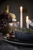 Candles on festively decorated table (detail)