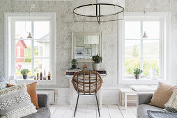 Rattan chair at desk in Scandi-style living room
