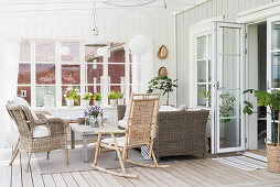 Wicker furniture and rocking chair in country-house-style conservatory