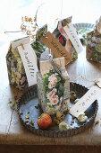 Selbstgebastelte Tüten aus alten Illustrierten für Saatgut