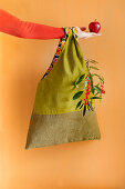 Hand-sewn green corduroy bag with contrasting lining