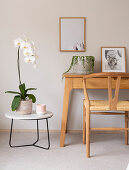 Orchid on side table next to console table and chair