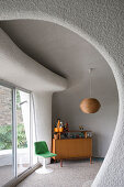 Retro living room with organically formed walls