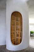 Small pantry with curtain and organically formed walls