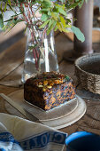 Piece of fruit cake on rustic wooden board