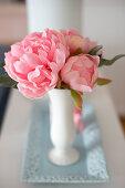 Pink camellias in vase