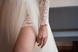 Bride wearing wedding gown with thigh-high slit