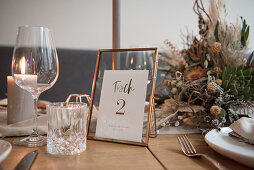 Table set for wedding with copper table number stand