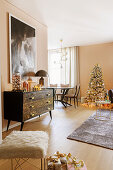 Elegant living room decorated in champagne and gold at Christmas