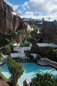 Pool and rock garden of the Villa Lagomar, Lanzarote, built into a cliff