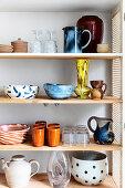 Retro stoneware crockery in refurbished cupboard