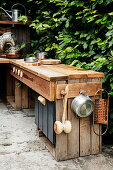 DIY outdoor play kitchen made from reclaimed wood on terrace