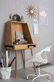 Modern writing desk and white designer chair