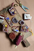 Handmade scented wax with dried flowers on wooden board