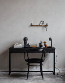 Black bistro chair at desk with vintage accessories