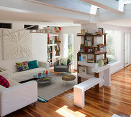 Shelves and furniture with loose covers in open-plan interior