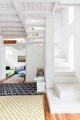 White staircase in open-plan interior