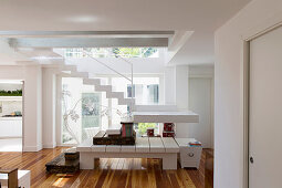 Staircase made from various types of steps in open-plan interior