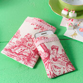 Hand-sewn mobile phone case made from red-and-white toile-de-jouy fabric