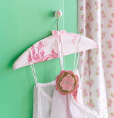 Clothes hanger covered with toile-de-jouy fabric and fabric flower