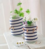 Vase covers made from arms of striped shirt