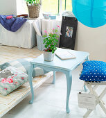 Old, renovated side table painted pale blue