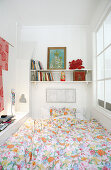 Shelves above bed in narrow room with interior window