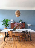 Dining room in mid-century style with blue wall