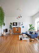 Large living room in mid-century style with wooden floor
