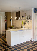 White furnishings and cement tiles in kitchen-dining room