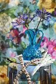 Blue agapanthus in blue vase