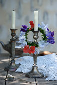 Wreath of sweet peas on silver candlestick