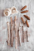 Craft materials for natural decorations: branches, fir cones and wool
