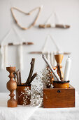 Natural, Bohemian-style arrangement of sticks, wool, candles and candle holders