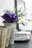 Purple eustomas in metal beaker
