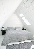 Rustic bedroom under wood-clad gable roof