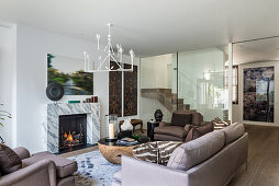 Exotic, eclectic mixture of styles in living room with marble fire surround
