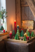 Festive arrangement of handmade paper Christmas trees and candles