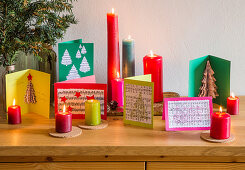 Handmade Christmas cards with motifs made from recycled paper