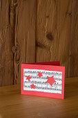 Handmade Christmas card with motif made from sheet music