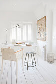 Wooden floor and desk in study decorated entirely in white