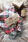 Tartan sachet and wrapped gifts on fur rug